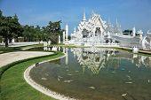 CHIANG RAI PROVINCE, THAILAND - APRIL 18, 2011: Fantastic snow-white palace Wat Rong Khun. It is bui