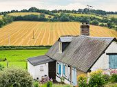 picture of household farm  - peasant farm and harvested field in Normandy France - JPG