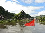 image of moselle  - red flag and Cochem town on Moselle river in Germany - JPG
