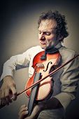 Skillful violinist playing with his heart