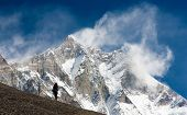 Lhotse With Windstorm, Turist And Snow Clouds