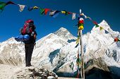 View Of Everest With Tourist And Buddhist Prayer Flags