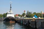 Black Tug With White Superstructure Stands In Burgas