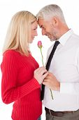 Romantic mature couple holding rose over white background