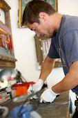 Man working in bicycle workshop