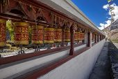 pic of mustang  - Colorful tibetan prayer wheels in Marpa village Mustang Nepal - JPG
