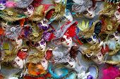stock photo of venetian carnival  - Rows of venetian carnival masks for sale - JPG