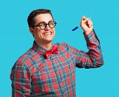 Nerd With Pen And Glasses On Blue Background.