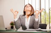 pic of breathing exercise  - Stressed young business woman doing some breathing exercises and meditating at her office - JPG