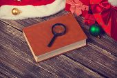 Book And Loupe With Chirstmas Gifts
