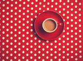 Cup Of Coffee On Speckled Background.