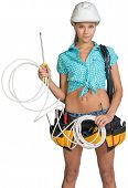 pic of coil  - Woman wearing hard hat and tool belt - JPG