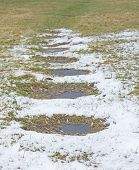 foto of stepping stones  - Frosty path with slate stepping stones leading to green grass - JPG