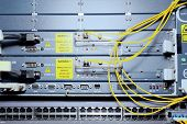 pic of telecommunications equipment  - Telecommunication equipment of network cables in a datacenter of mobile operator - JPG