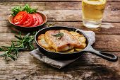 foto of baked potato  - Baked fish fillets with potatoes in a frying pan - JPG