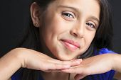 pic of sissy  - A Columbian Little Girl Fun Look in front of a black background - JPG
