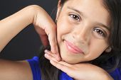 stock photo of sissi  - A Columbian Little Girl Fun Look in front of a black background - JPG