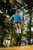 Boy Having Fun At Playground