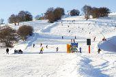 Downhill On Ski Slopes