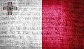 Malta flag on burlap fabric
