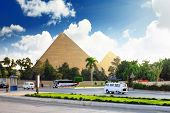 Pyramids And Present Day Of Giza Town