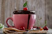 chocolate cake in a mug on a wooden surface