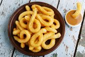 picture of churros  - churros sweet dessert with caramel plate on a wooden surface - JPG