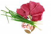 stock photo of boeuf  - Cut of beef steak with laurel onion garlic and flavouring - JPG
