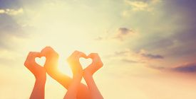 picture of hand god  - people holding hands on a sunset background - JPG