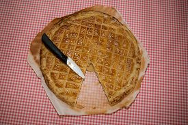 foto of epiphany  - An epiphany cake on the table with a knife to cut it