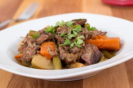 stock photo of pot roast  - braised beef pot roast stew with vegetables on table