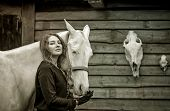picture of horse face  - Young woman and her cremello horse on the background of horse and deer skulls - JPG