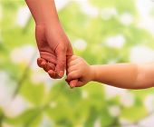 picture of trust  - Male hand leading child - JPG