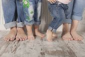 pic of barefoot  - dad mom and daughters barefoot with jeans - JPG