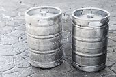 stock photo of keg  - Used aluminum kegs small barrels commonly used to store transport and serve beer - JPG