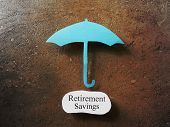 image of retirement  - Paper umbrella over a Retirement Savings message - JPG