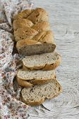 foto of pecan  - fresh homemade bread with whole wheat flour flax seeds and pecans on a light wooden surface - JPG