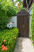 stock photo of mailbox  - Wooden Doorway On A White Wall With White Mailbox - JPG