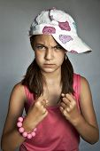 picture of clenched fist  - Girl with clenched fists on a gray background - JPG
