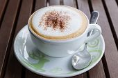 image of latte  - Cappuccino or latte coffee on wooden table in the cafe - JPG