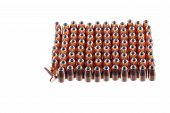 stock photo of hollow point  - 9mm hollow point bullets lined up ready for reloading with one laying on its side as a odd man out - JPG
