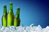 stock photo of bottle water  - cold beer bottle with water droplets on surface - JPG