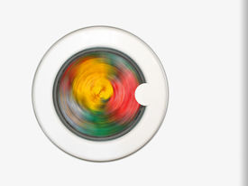 stock photo of washing machine  - colorful clothing in washing machine cloth rotation - JPG