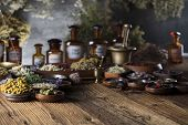 Alternative Medicine. Herbs In Bowls, Mortar And Medicine Bottles On Wooden Rustic Table. poster