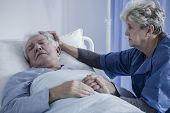 Caring Wife Comforting Elderly Husband poster