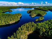 Aerial View Of Blue Lakes And Green Forests On A Sunny Summer Day In Finland. poster