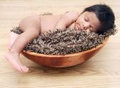 foto of naturel  - Newborn baby boy asleep sleeping on a broan throw  - JPG