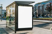 Vertical Blank White Billboard At Bus Stop On City Street. In The Background Buildings And Road. Moc poster