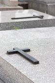 stock photo of burial-vault  - Christian grave with cross on the vault - JPG