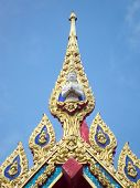 gaurd of buddha on the top of thai temple entrance